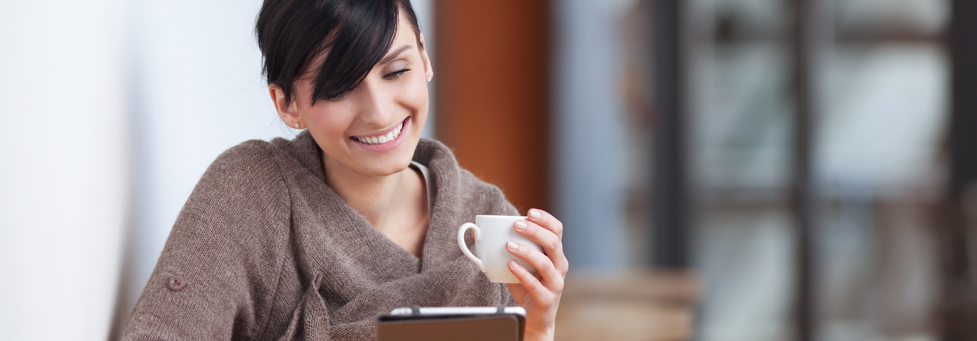 Woman happy with our office coffee services in Montreal, QC.